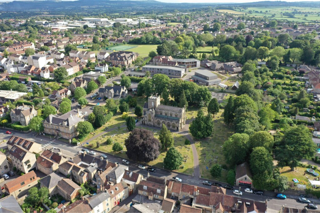 Panoramic view of village with church in centre. Atwell Care Ltd. Live in care. Home Care. Care Company. Bath. Frome. Keynsham. Saltford.